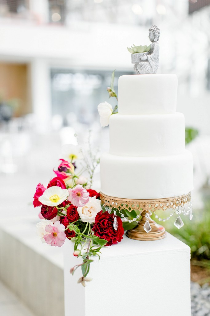 The wedding cake was a plain white one, topped with a Buddha