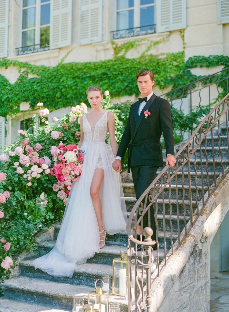 The whole chateau was surrounded with lush greenery and pink blooms to match the wedding color scheme