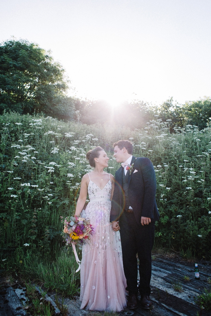 a blush A-line wedding dress with delicate and chic blush floral embroidery all over the gown and spaghetti straps for a summer wedding