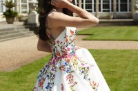 a modern wedding ballgown with colorful floral embroidery is a cool idea for a modern and color-loving bride