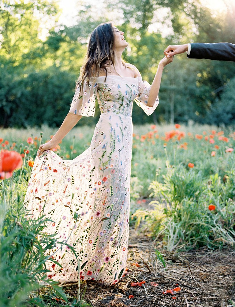 a romantic off the shoulder sheath wedding dress with an illusion skirt and wildflower embroidery in bold colors