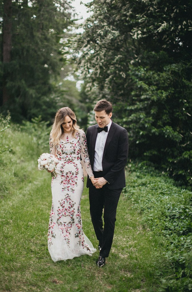 a romantic sheath wedding dress with an illusion neckline and long sleeves plus blush and purple floral embroidery