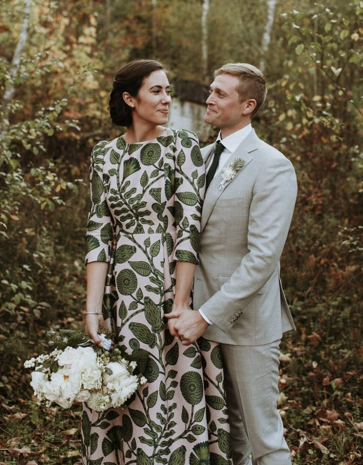 This fall wedding was done in green and white, with a cozy feel and a chic printed wedding dress