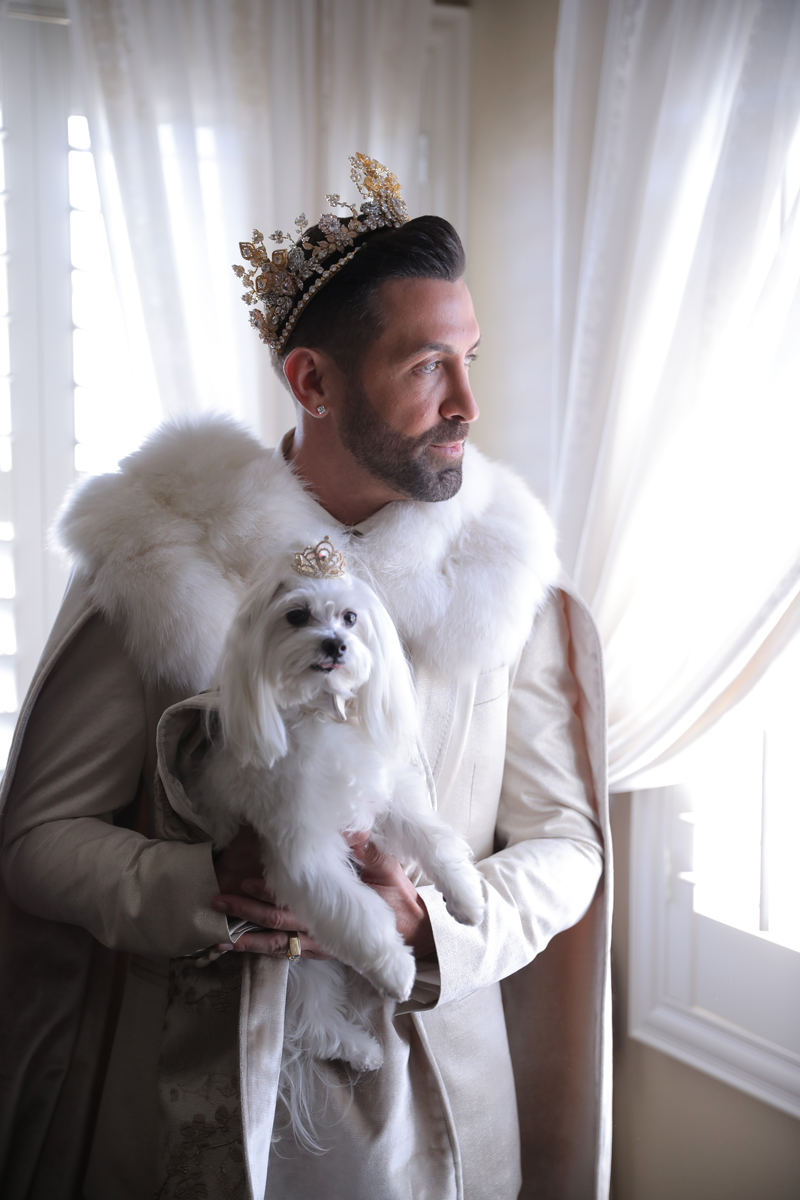 Both grooms were wearing white and gold, luxurious crowns and their dogs were dressed, too