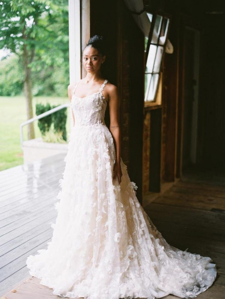 The first wedding dress was a breathtaking Al-line floral applique wedding gown with straps and a train