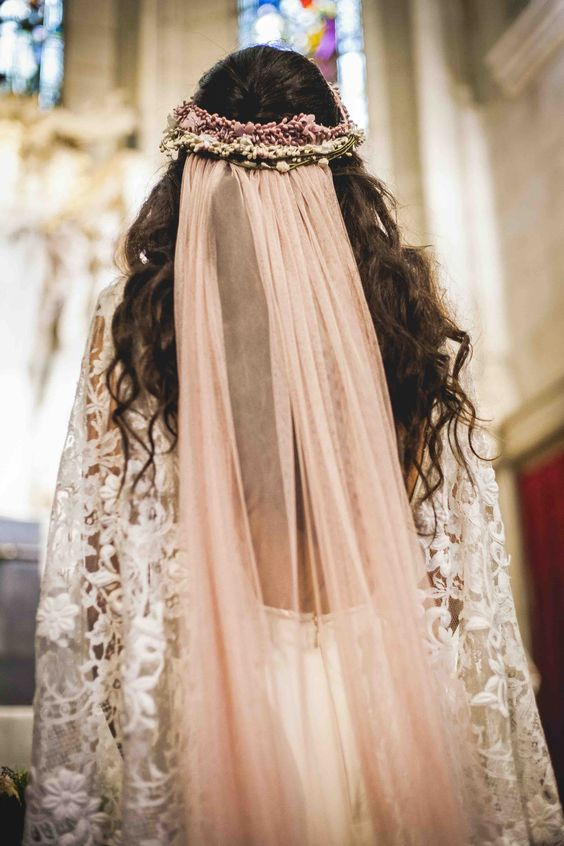 a blush veil attached to a fresh flower crown for giving an ultimate boho look to the bride