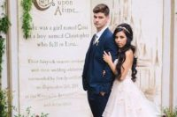 02 a fairy tale book with greenery and blooms as a wedding backdrop for a fairy tale wedding is perfection