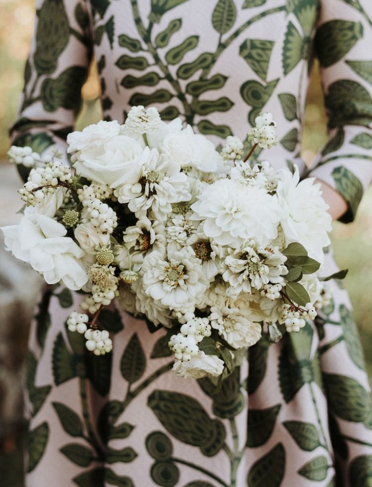The bouquet was all-white, with snowberries and looked very elegant and chic