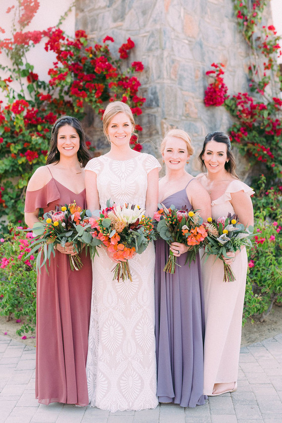 The bridesmaids were rocking simple and romantic mismatching dresses in muted and pastel shades