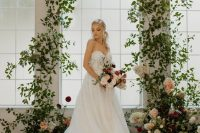 03 a fairy-tale wedding altar of greenery with white, blush and burgundy blooms is very sophisticated and chic