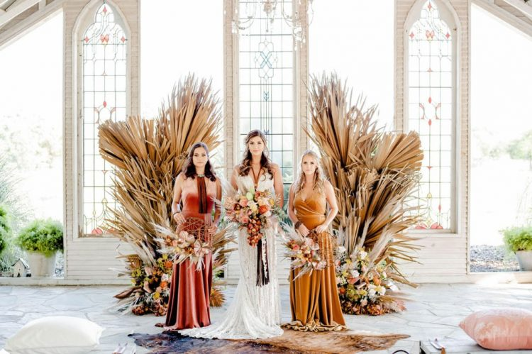 The bridesmaids were wearing mismatching terracotta and mustard velvet dresses