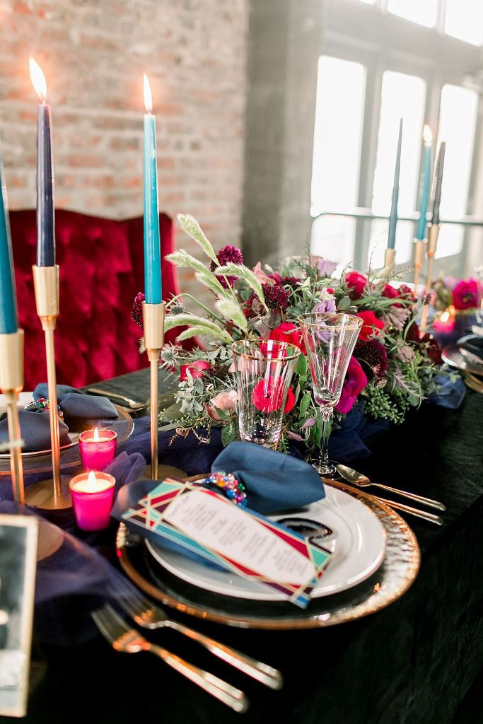 Bright candleholders and gemstone napkin rings accessorized the tablescape