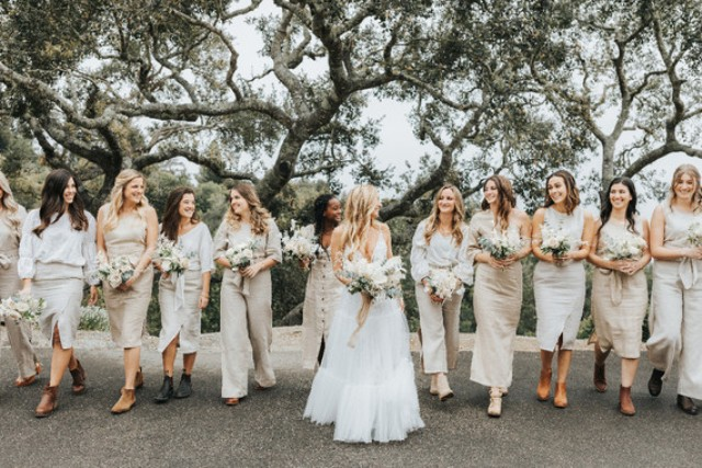 The bridesmaids were rocking mismatching neutral boho looks and carrying similar bouquets