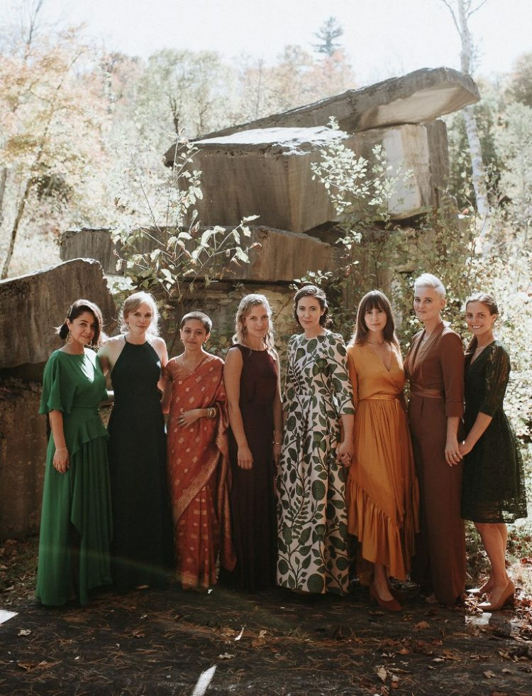 The bridesmaids were wearing mismatching fall-colored dresses