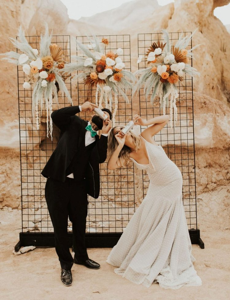 The groom was wearing a black three-piece suit with a green bow tie