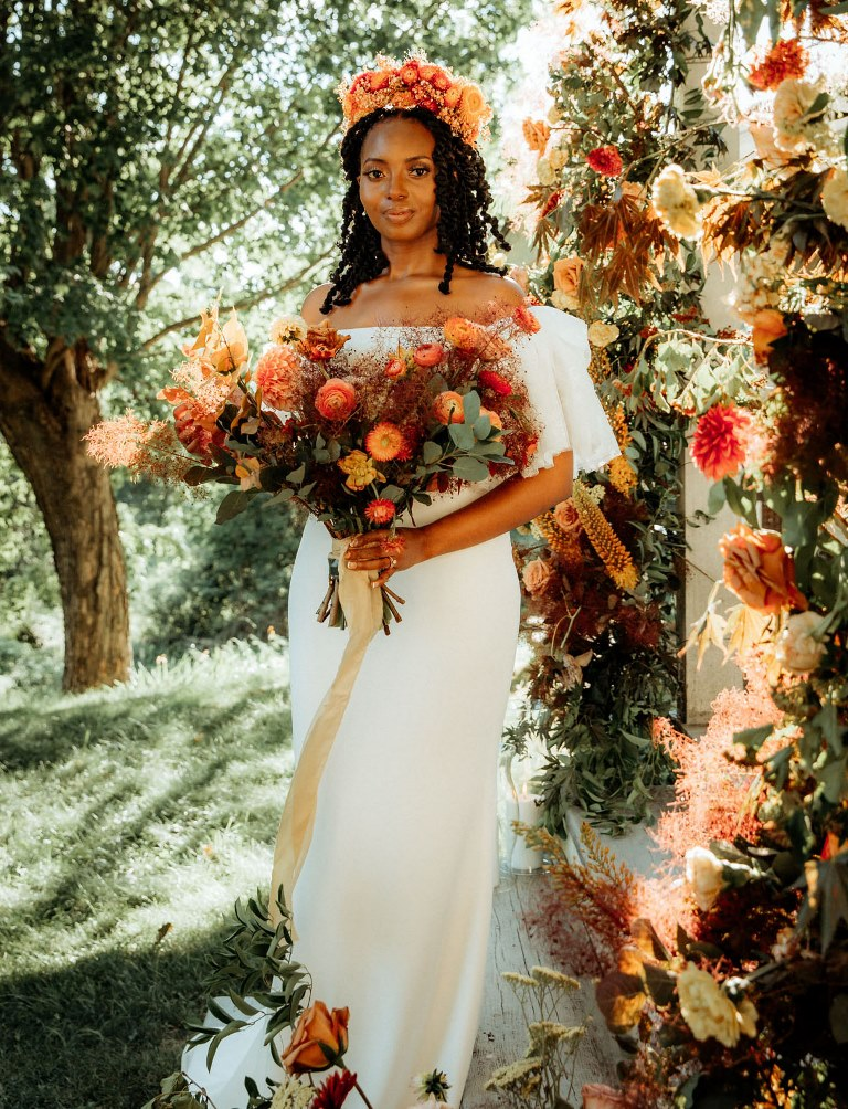 The wedding bouquet was a matching one, with bold blooms and foliage