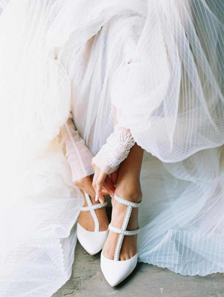 The wedding shoes were strappy and embellished and finished off the looks perfectly