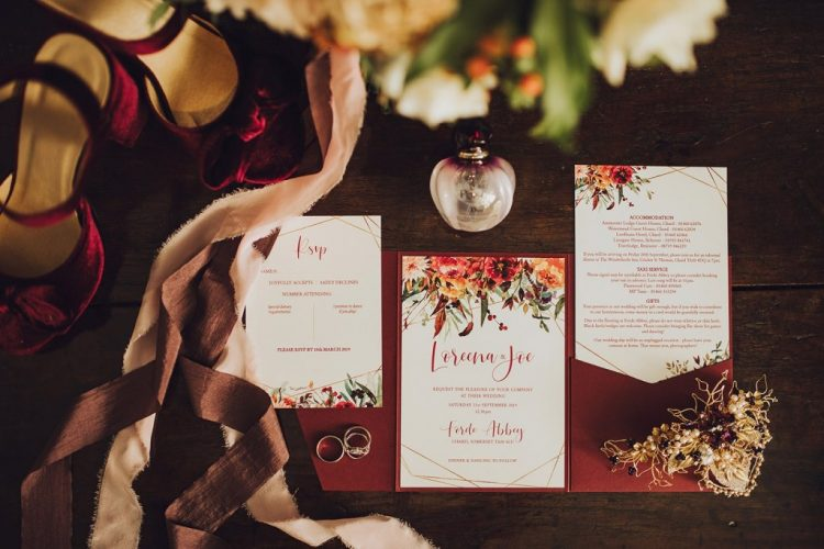 The wedding stationery was elegant, with burgundy blooms and the bridal shoes were of burgundy velvet