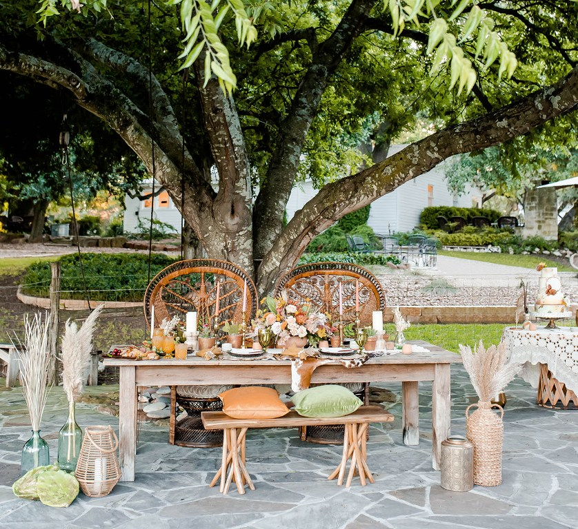 I love the natural tones of this tablescape with blooms, succulents, cacti and pillows