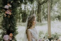 06 a romantic fairy tale wedding arch of a refined picture frame decorated with greenery and blush blooms is a refined piece