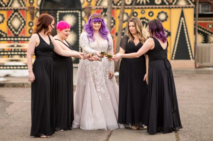 The bridesmaids were wearing black draped A-line maxi dresses