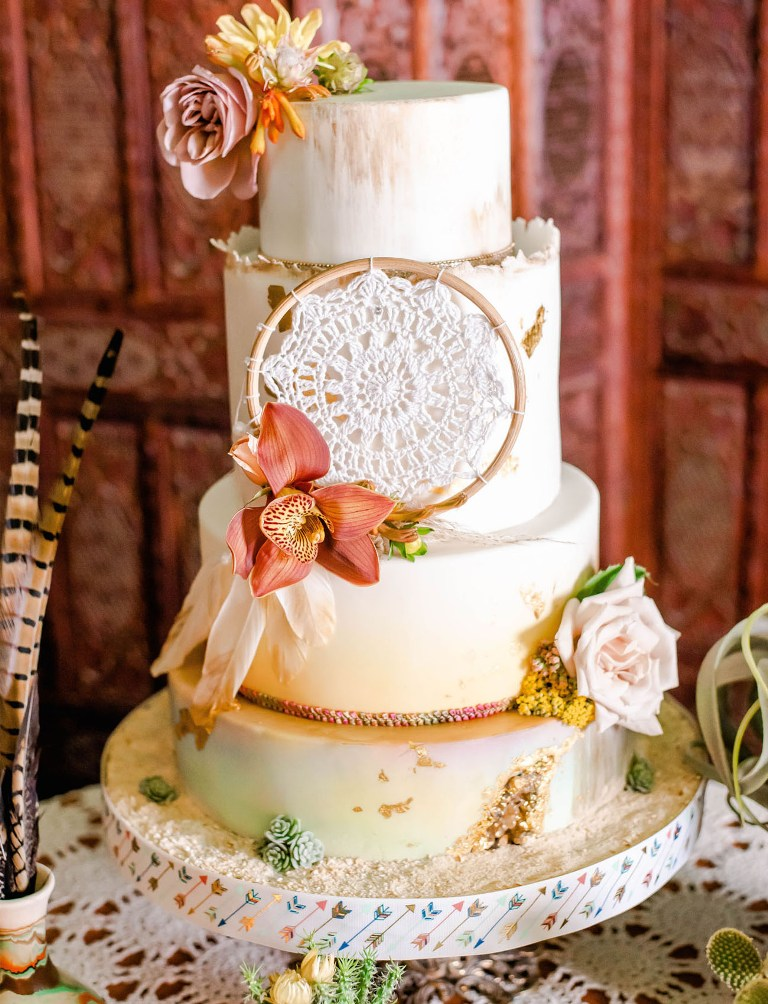 a hand painted boho wedding cake design