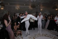 08 Here's one more look of the grooms – white fitting sparkling jumpsuits and sneakers