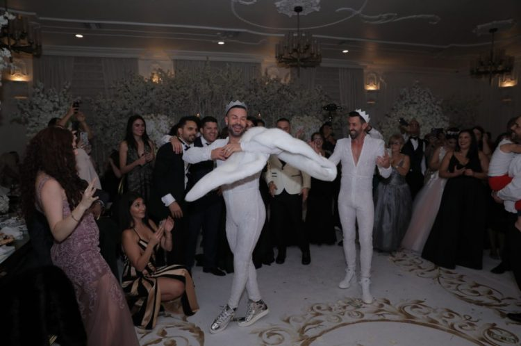 Here's one more look of the grooms - white fitting sparkling jumpsuits and sneakers
