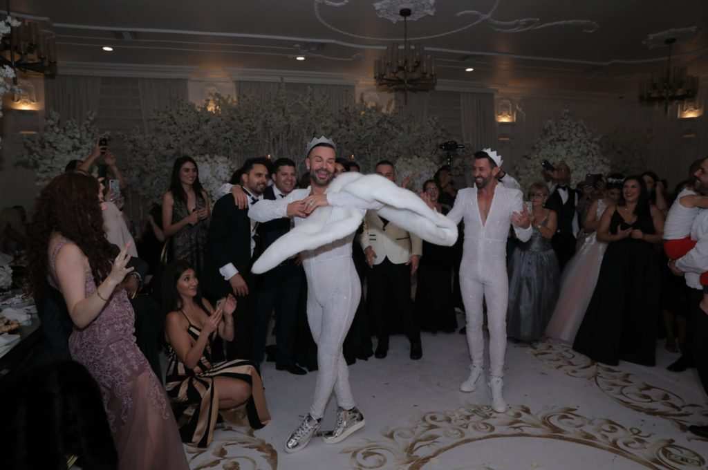 Here's one more look of the grooms   white fitting sparkling jumpsuits and sneakers