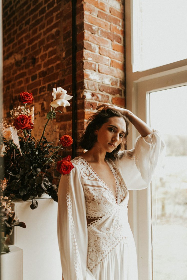 The bride also tried on a boho lace A-line wedding dress with a cutout back and sides