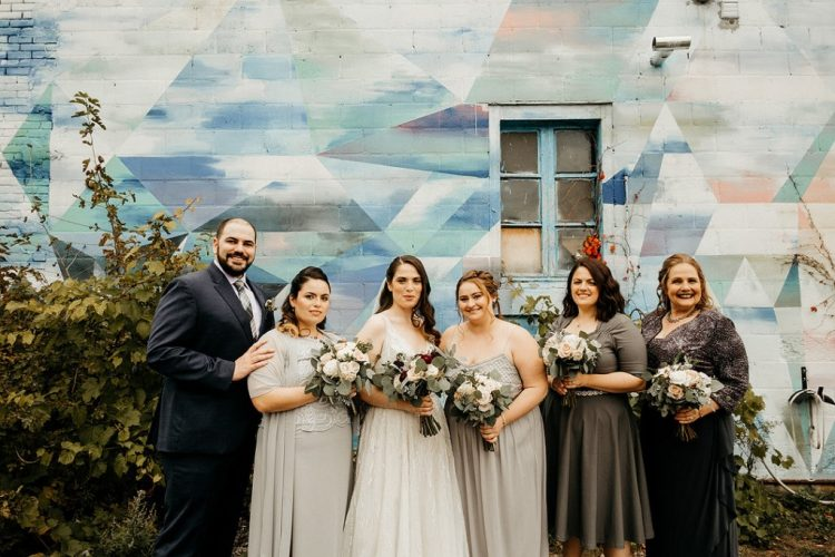 The bridesmaids were rocking mismatching light and dark grey dresses