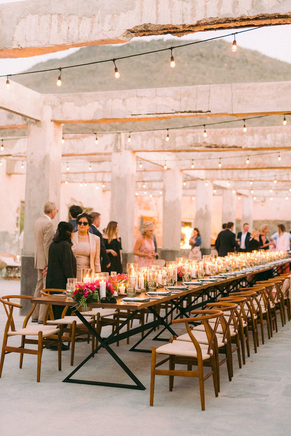 The wedding reception was an outdoor one, with stylish modern furniture and lots of candles