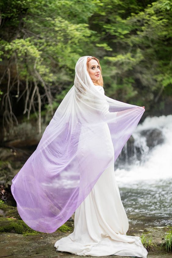 a modern plain sheath wedding dress paired with an ombre white to purple veil for an ultimate look
