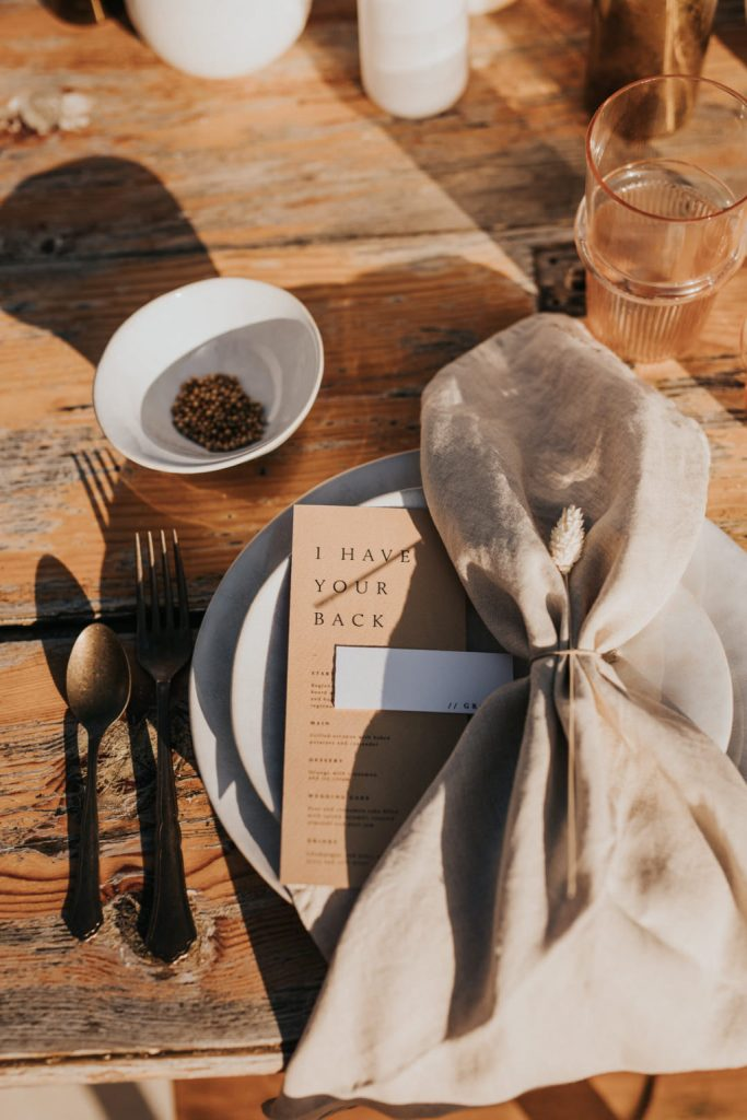 The uncovered table, neutral linens and vintage cutlery added to the feel of a rural place