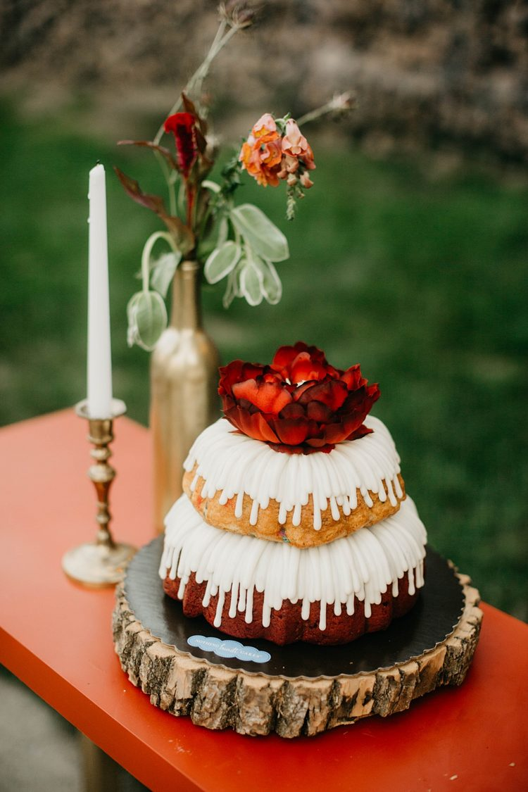 There was a large bundt wedding cake with glazing and a bloom on top
