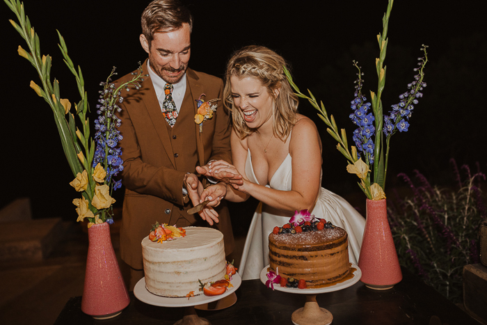 There were two different wedding cakes topped with blooms, berries and fruits