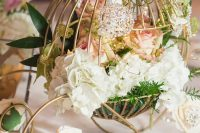 09 a beautiful fairy tale wedding centerpiece of a wire carriage with blush and white blooms, greenery and candles