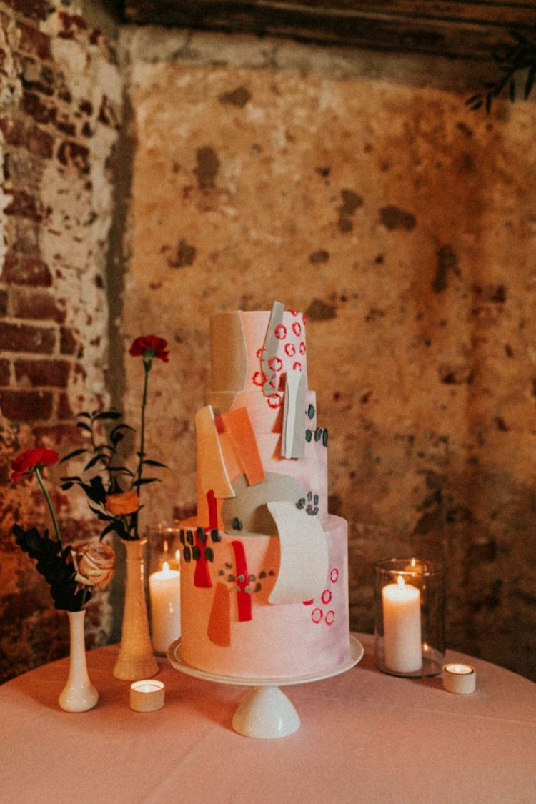 The second wedding cake in red, orange, pink, with white and grey chocolate shards