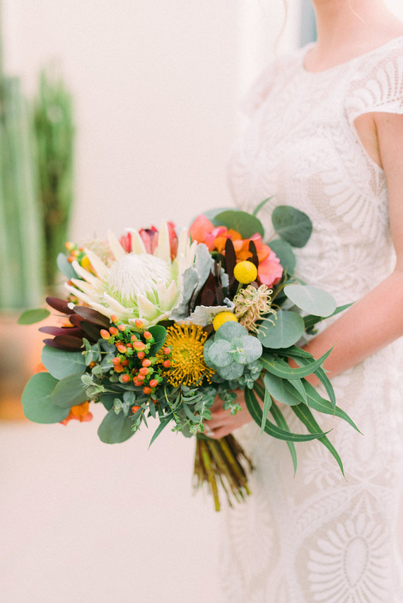 The wedding bouquet featured bright blooms, greenery and various proteas