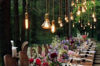 10 a colorful fairy tale wedding tablescape with lots of bulbs, colorful blooms and candles and some cards