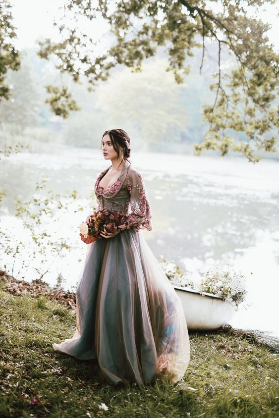 a purple grey A-line wedding dress with a floral embroidery bodice and long sleeves, a deep neckline and a train