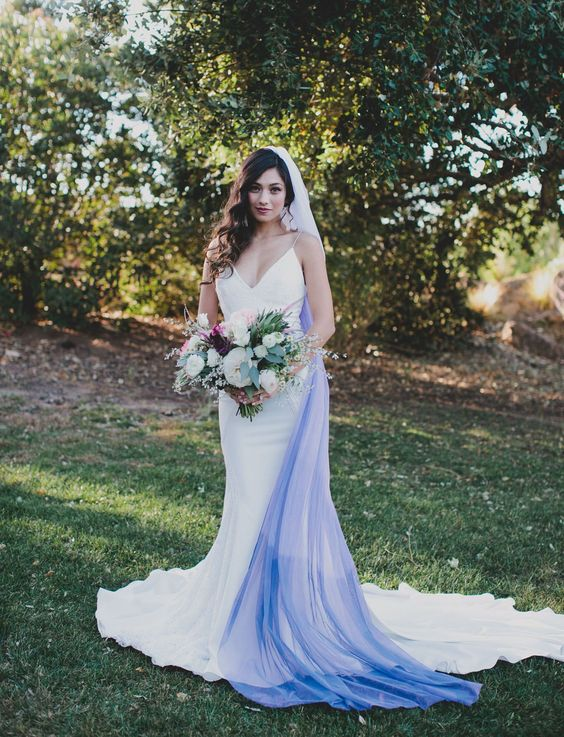 a modern plain mermaid wedding dress with spaghetti straps and an ombre white blue veil for a bold look