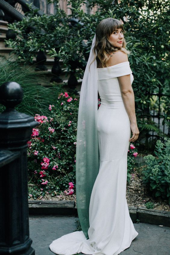 a modern plain off the shoulder mermaid wedding dress plus an ombre white to green veil for a touch of color and a modern twist
