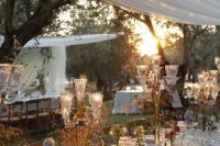 16 a fairy tale wedding tablescape with a floral tablecloth, dried and fresh blooms, candles and elegant cutlery