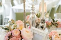17 a fairy tale wedding tablescape with lots of blush and pink blooms, candles and mercury glass candleholders and vases is very elegant and chic
