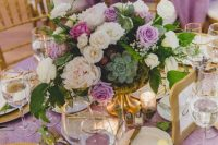 18 a lavender fairy tale wedding tablescape of white and lavender blooms, lavender tablecloth, succulents, gold chargers and cutlery