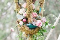 19 a magical wedding decoration with blush, pink blooms, moss and greenery looks really enchanted and chic