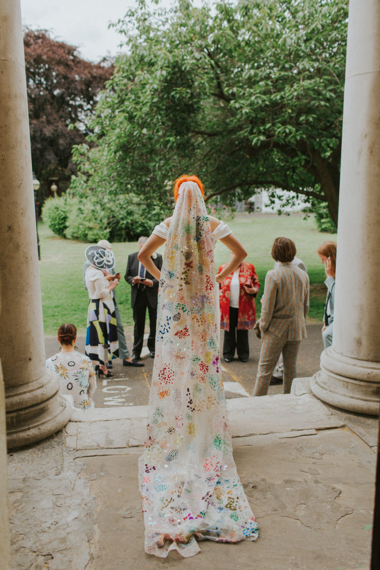 a statement colorful veil with embroidery, sequins and in bold colors is a unique accessory for a color-loving bride