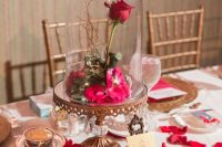 20 a refined fairy tale wedding centerpiece of a vintage cloche, bright petals, a rose, crystals and a vintage frame