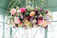 21 a refined floral chandelier of a sphere, crystals, bright blooms and greenery is a great solution for a fairy tale wedding
